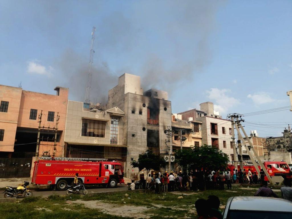Fire breaks out in a popcorn making factory in Delhi's Bawana on Aug 27, 2018.
