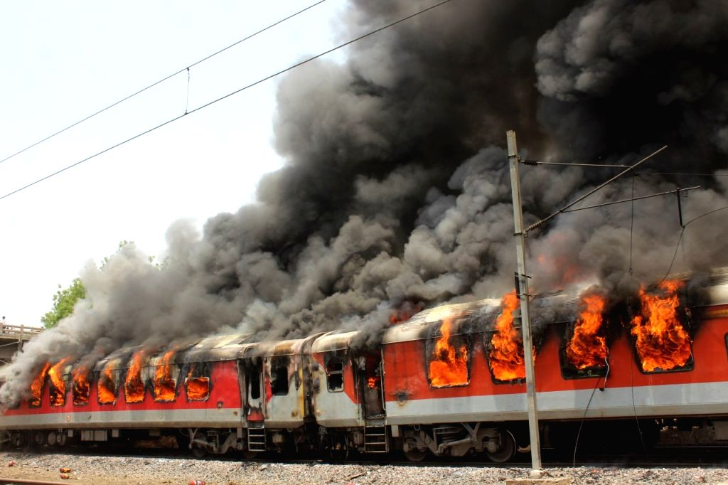 Fire breaks out in two coaches of the A.P. Express, near Birlanagar in Madhya Pradesh on May 21, 2018. According to a Railway Ministry official, the fire was detected in the B-6 coach ...