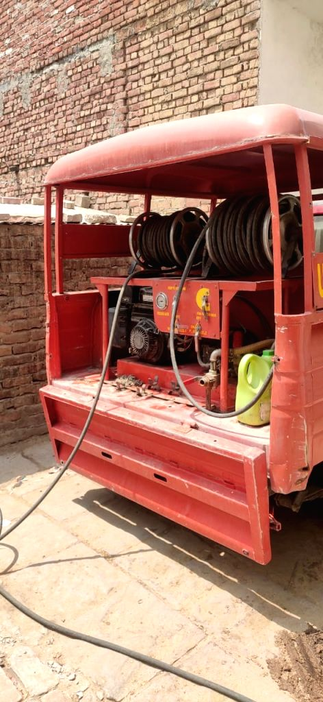 Fire brigade vehicles getting sanitized in UP.