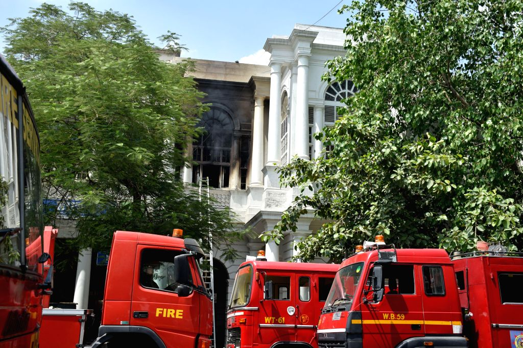 Fire engines parked near a building in Connaught Place area of Delhi where a fire broke out on Aug 25, 2014. The fire broke out inside an NIIT (National Institute of Information Technology) computer .