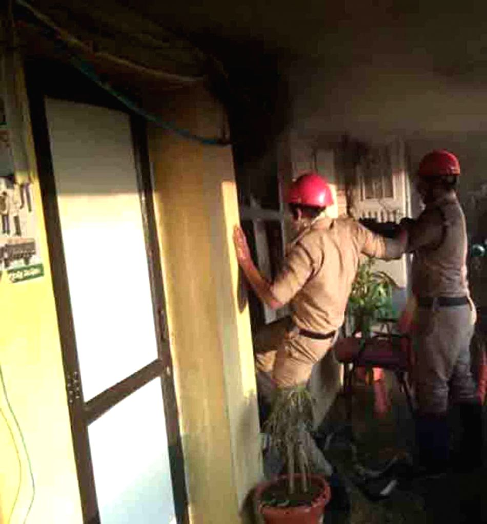 Fire fighters arrive to douse blaze after fire broke out on the first floor of the GHMC office in Khairatabad, Hyderabad on Feb 6, 2018.