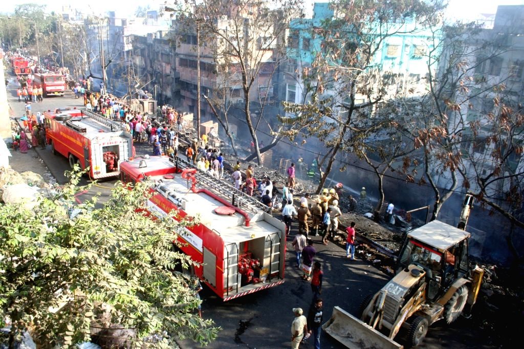 Fire fighters at the site where a fire broke out in Dunlop, Kolkata on Feb 12, 2019.