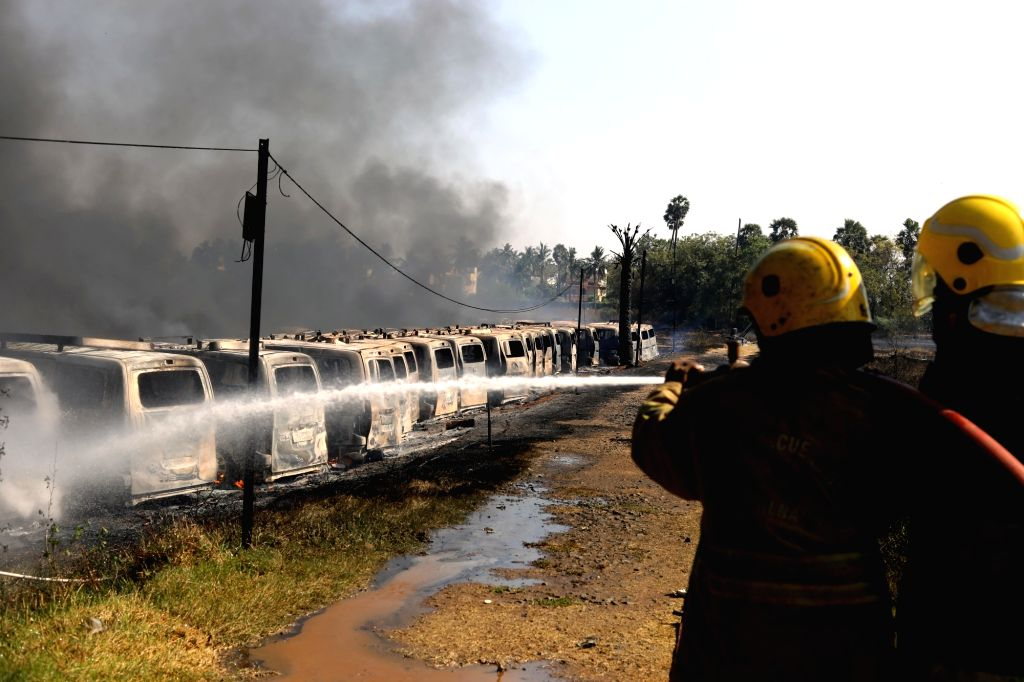 Fire fighters busy dousing a fire that broke out in the parking lot near the Sri Ramachandra Medical Centre gutting 174 cars in Porur area of Chennai on Feb 24, 2019.