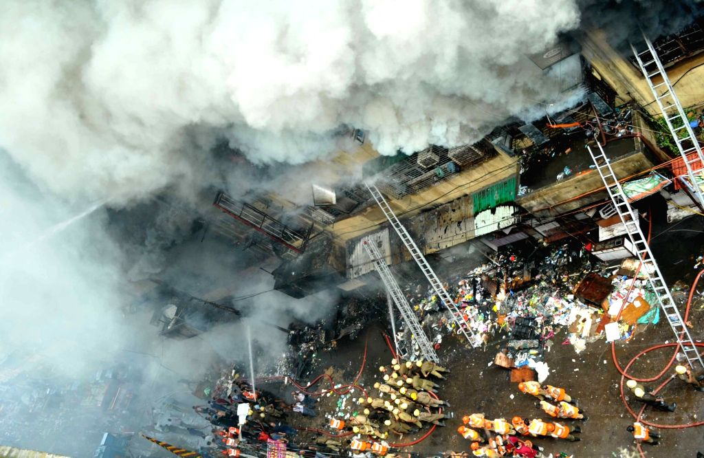 Fire fighters busy dousing a massive fire that erupted around 2.45 a.m at Bagree Market, a wholesale market in Kolkata on Sept 16, 2018. There were no reports of any casualty or injury.