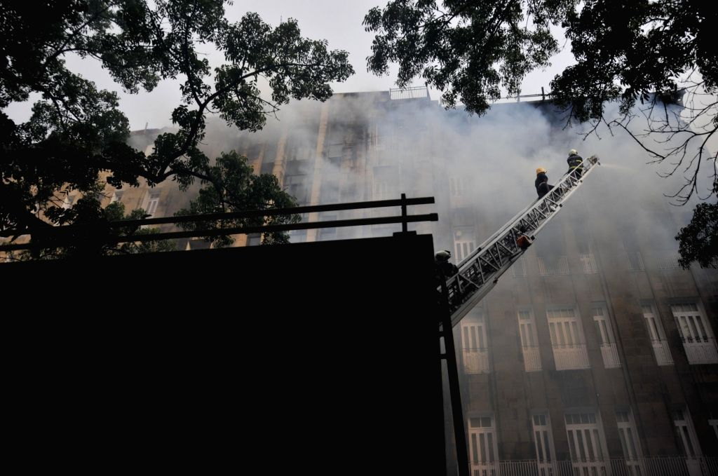 Fire fighters douse a fire that broke out at Scindia House in Mumbai, on June 1, 2018.