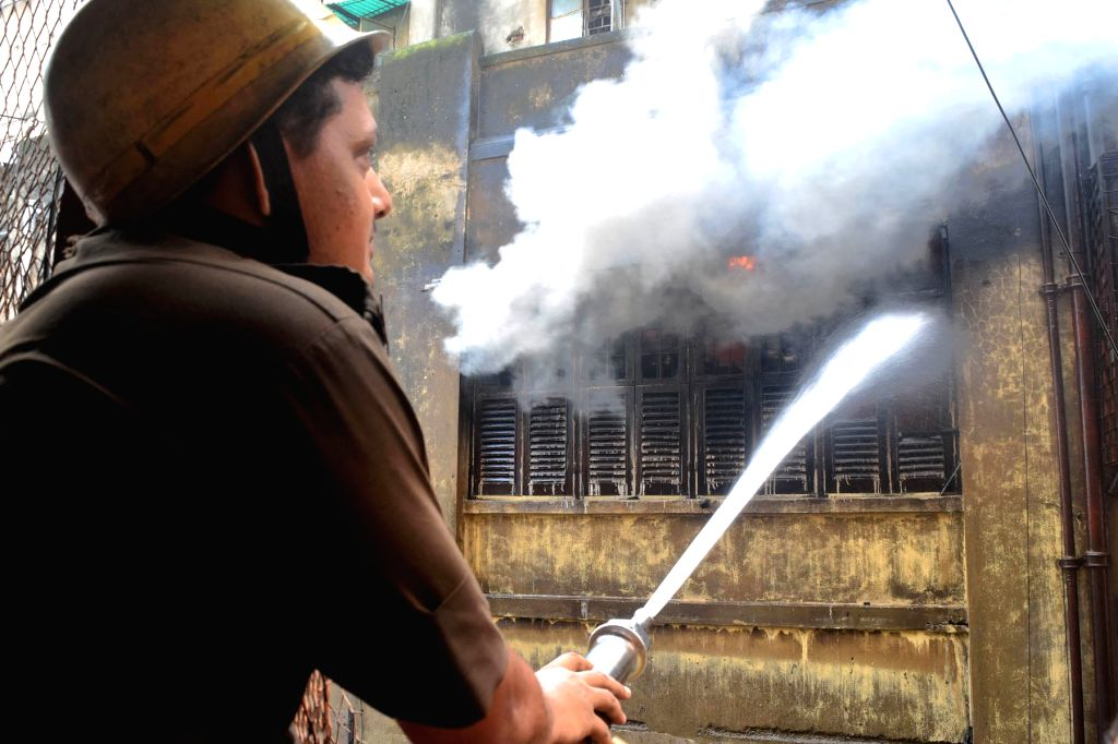Fire fighters douse a fire that broke out at Bagree market yesterday, in Kolkata on Sept 17, 2018.