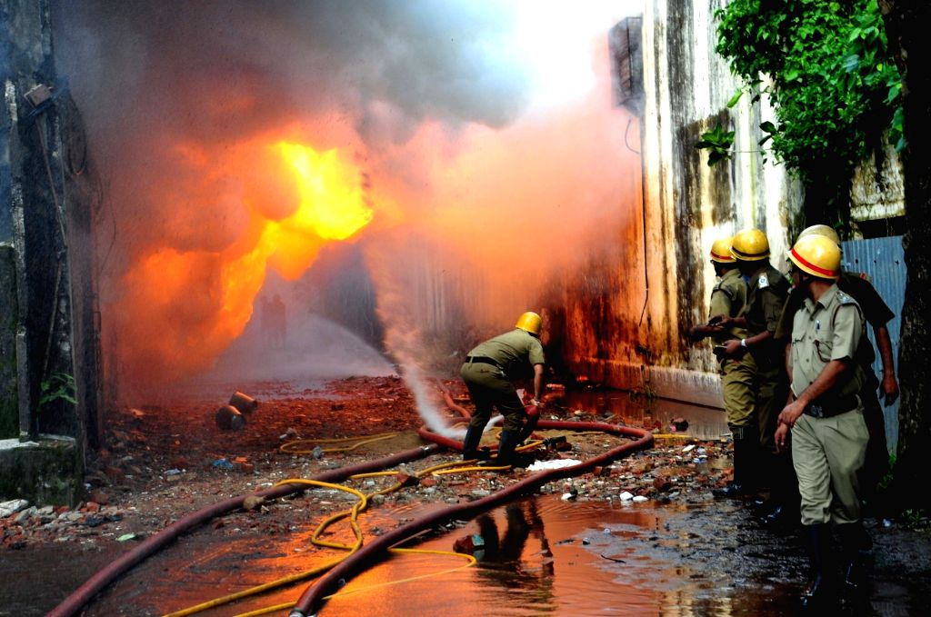 Fire fighters douse a fire that broke out at a chemical factory in Kolkata, on Oct 11, 2017.