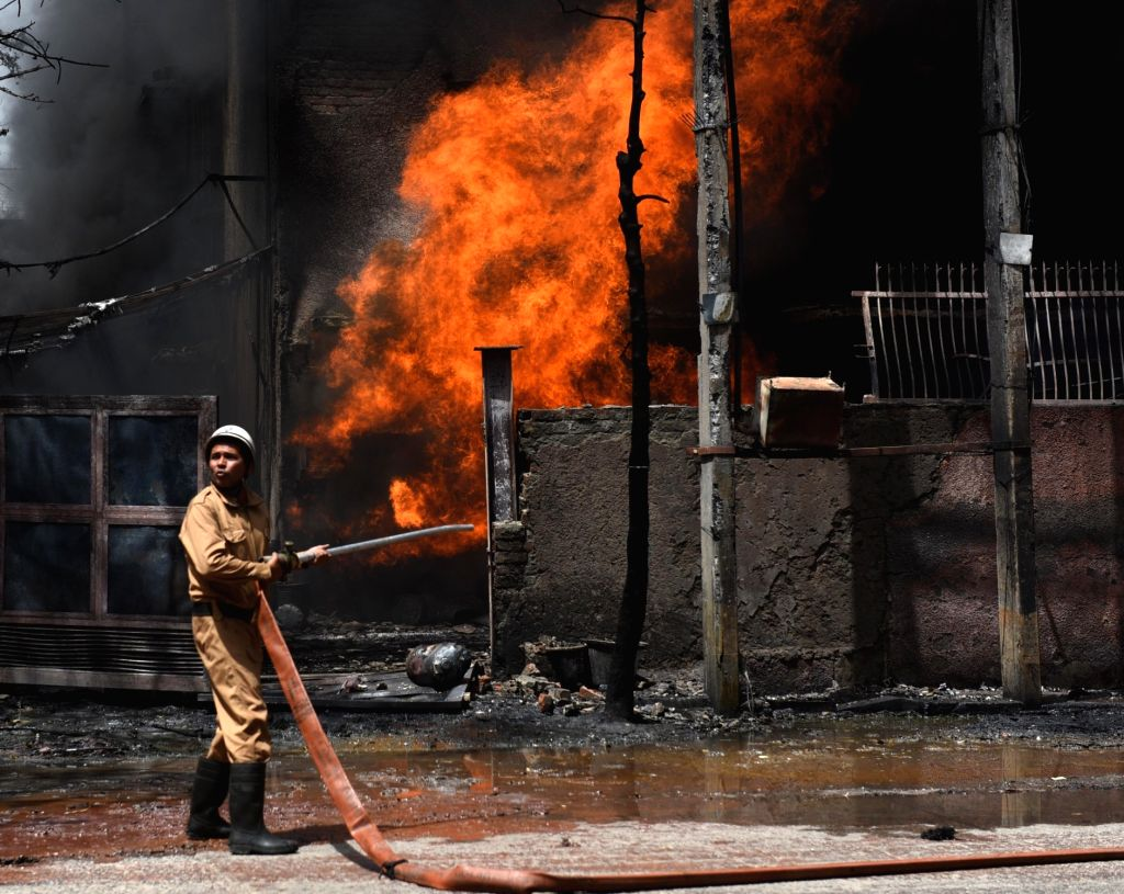 Fire fighters douse a fire that broke out at a chemical factory in Naraina, New Delhi on April 29, 2019.
