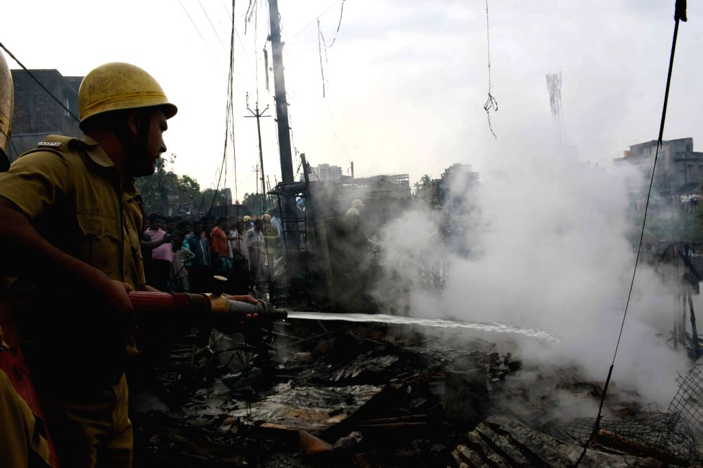 Fire fighters douse a fire that broke out in Kolkata's New Town on April 10, 2019.