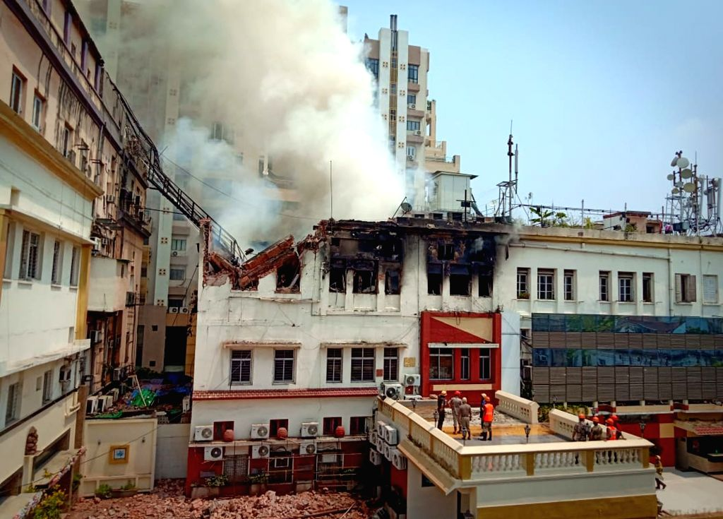 Fire fighters douse a fire that broke out in a four-storeyed building in south Kolkata's bustling Chowringhee Road, in Kolkata, on April 26, 2019.