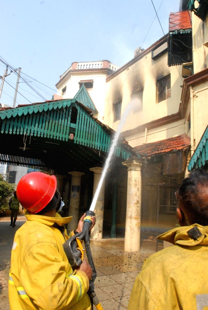 Fire fighters douse fire after fire broke out at the record room of Road Transport Authority (RTA) office at Khairatabad in Hyderabad on Jan 24, 2018.