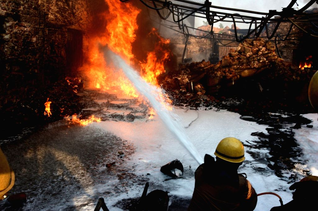 Fire fighters douse fire that broke out at a chemical factory at Vishwakarma industrial area in Jaipur on Nov. 1, 2018.