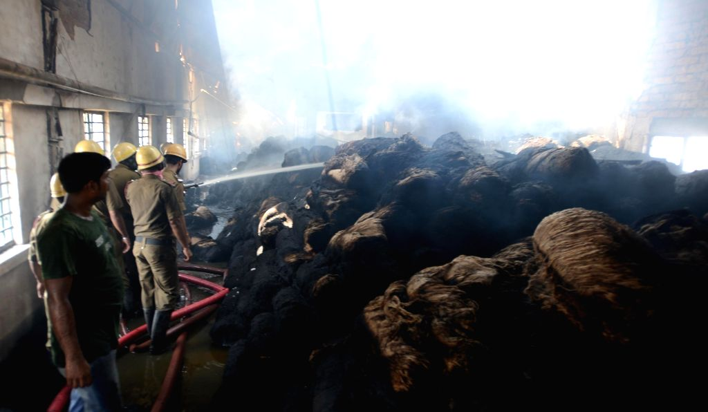 Fire fighters douse fire that broke out at Ambica Jute Mills at Belur in West Bengal's Howrah, on May 11, 2019.