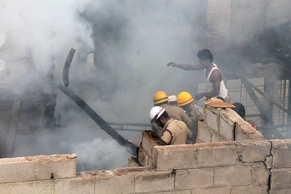 Fire fighters try to douse a fire that broke out in a furniture godown at KG Halli in Bangalore on July 9, 2014.