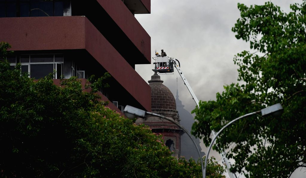 Fire fighters try to douse a fire that broke out in a 200 year-old building that houses State Bank of India headquarters in Chennai on July 12, 2014. No one is reported to be injured.