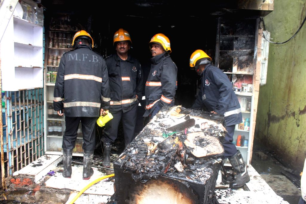 Fire fighters try to douse a fire that broke out at a Mumbai pharmacy on June 30, 2016. Reportedly nine persons, including three infants, were killed.