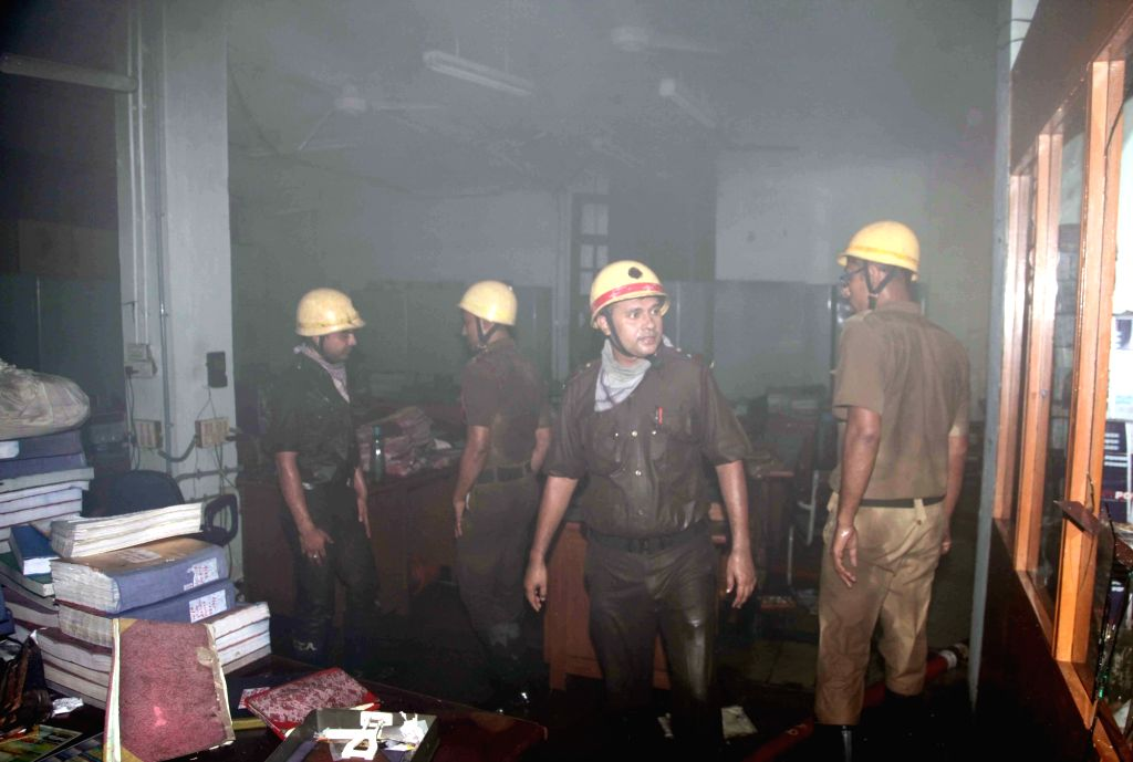 Fire fighters try to douse a fire that broke out at Allahabad Bank head Quarter in Kolkata on July 5, 2016.