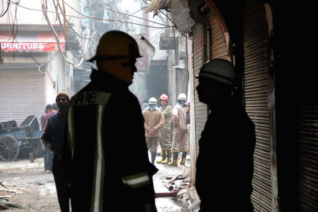 Fire fighting operations underway after a fire broke out at a factory in the Anaj Mandi area of Delhi's Rani Jhansi Road area, in Delhi on Dec 8, 2019. Reportedly 43 people were killed and ...