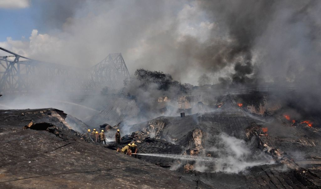 Fire fighting operations underway at a chemical godown where a massive fire broke out near Jagannath Ghat in Kolkata, on June 8, 2019.