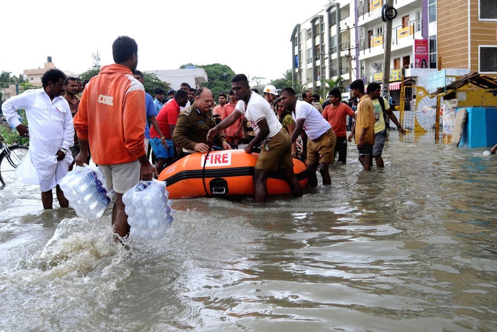 Fire personnel carry out rescue operation at a flooded streets of Bengaluru after heavy rains in Patna on July 29, 2016.