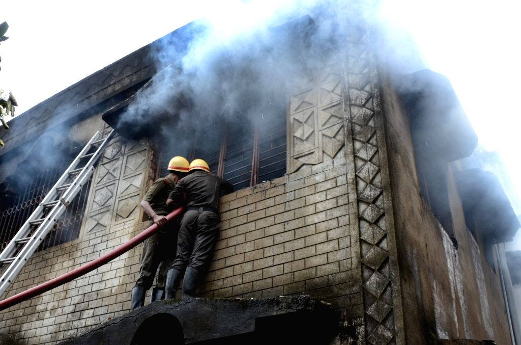 Fire personnel douse fire in incense stick workshop in Kolkata on Sept 24, 2016.