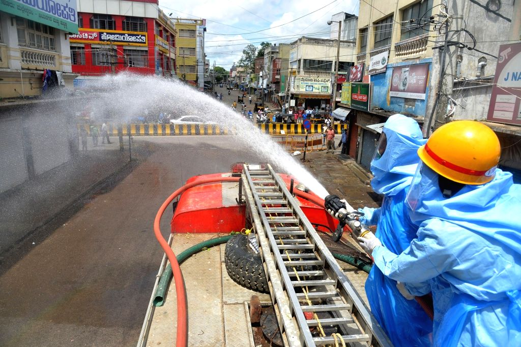 Fire personnel engaged in conducting sanitisation drive across public places in Mysuru amid rising cases of COVID-19, on June 25, 2020.