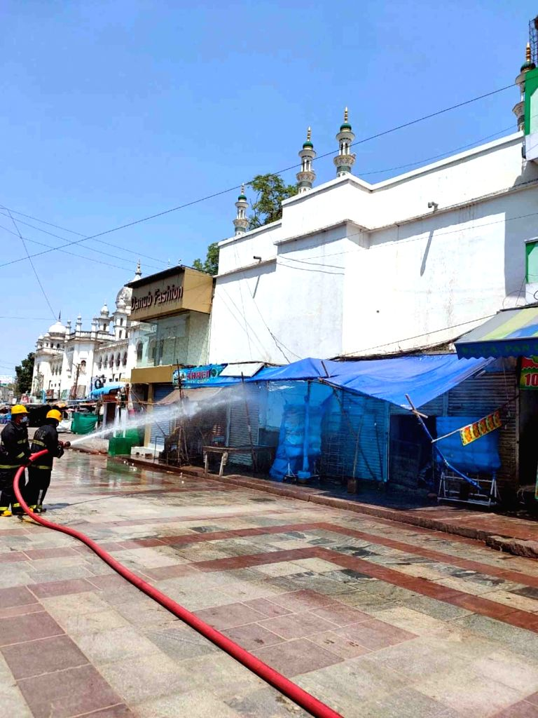 Fire personnel spray disnfectants across Hyderabad on Day 2 of the 21-day nationwide lockdown imposed by the Narendra Modi government over the coronavirus pandemic; on March 26, 2020. - Narendra Modi