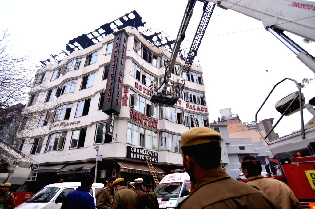 Fire service officials try to douse fire at Arpit Palace Hotel in Karol Bagh, New Delhi on Feb. 12, 2019. A child and 16 others, including a woman was killed in a major fire  that engulfed ...