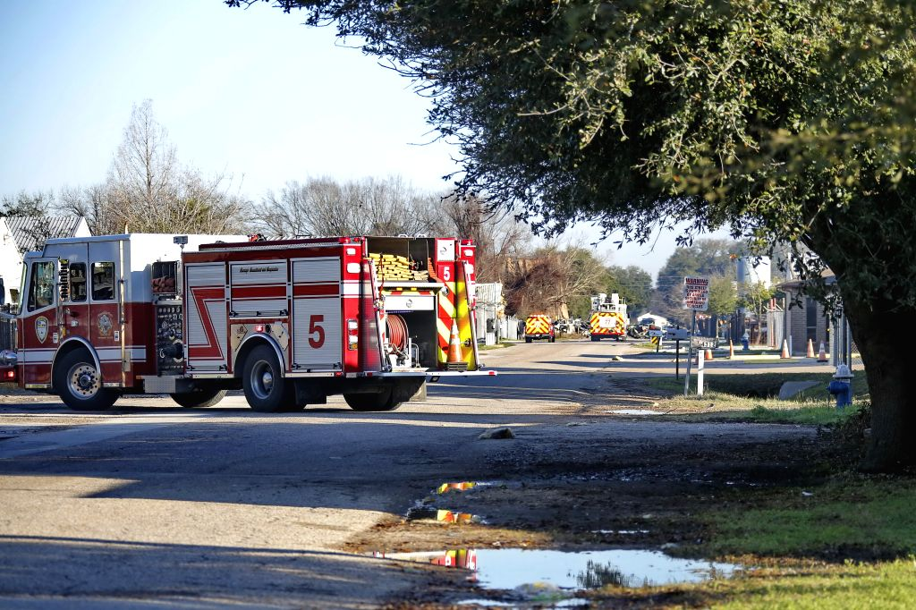 Fire trucks are seen near an explosion site in Houston of Texas, the United States, Jan. 24, 2020. At least two people were confirmed dead in the large explosion at ...