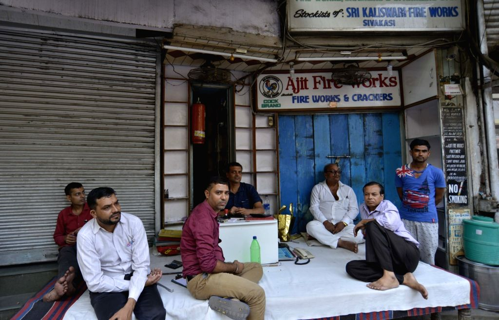 Firecracker traders sit idle outside their shops near a Jama Masjid market in Delhi on Oct 9, 2017. The Supreme Court on 9th October ruled that there will be no sale of firecrackers during ...