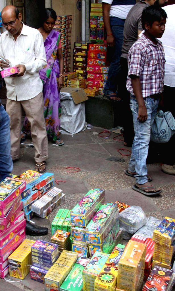 Firecrackers being sold near Jama Masjid ahead of Diwali - festival of lights - in New Delhi, on Oct 13, 2017.