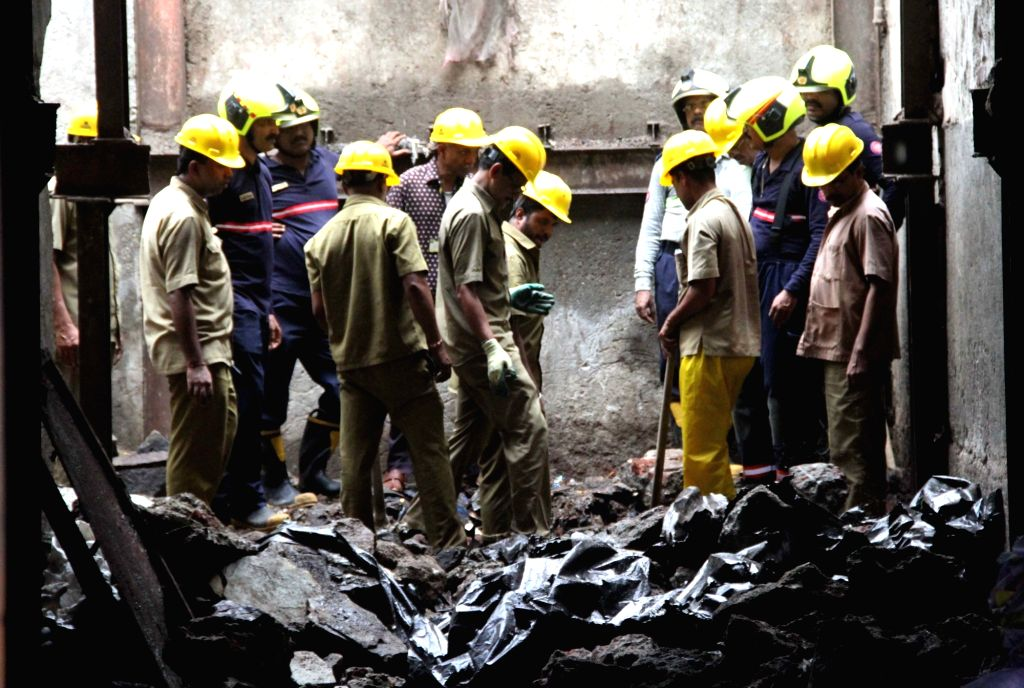 Firefighters and BMC personnel carry out rescue operations at the site where a ceiling collapse at Dongri in Mumbai on Sep 9, 2019. Reportedly, one person was killed in the incident.