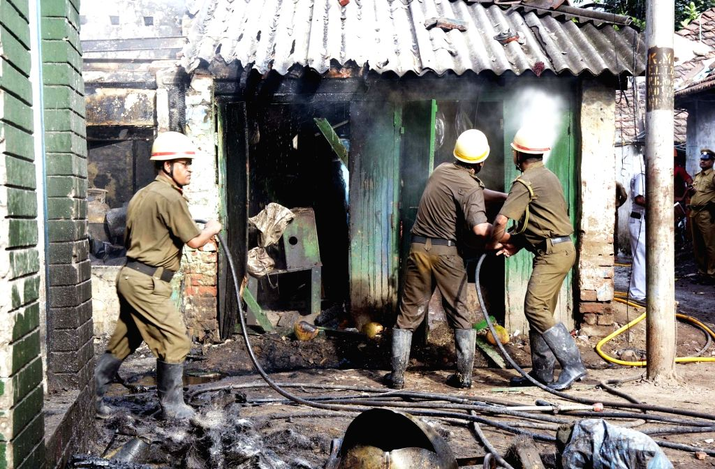 Firefighters douse a fire that broke out at an LPG gas cylinder godown in Kolkata on Oct 6, 2016. The reason of the fire is still not certain.