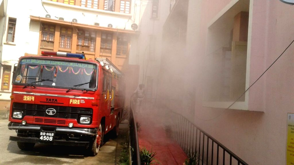 Firefighters douse a fire that broke out at Patna Secretariat Education Department at Vikash Bhawan in Patna on Sept 30, 2016.