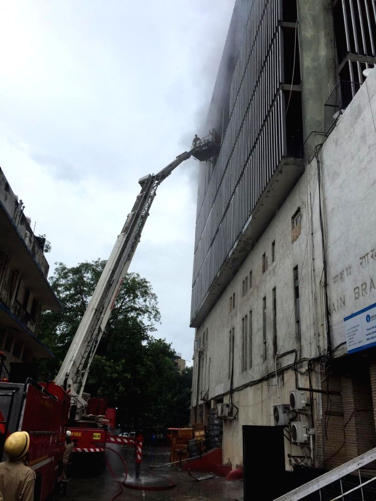 Firefighters douse a fire that broke out in SBI building in New Delhi's Sansad Marg on July 17, 2019.