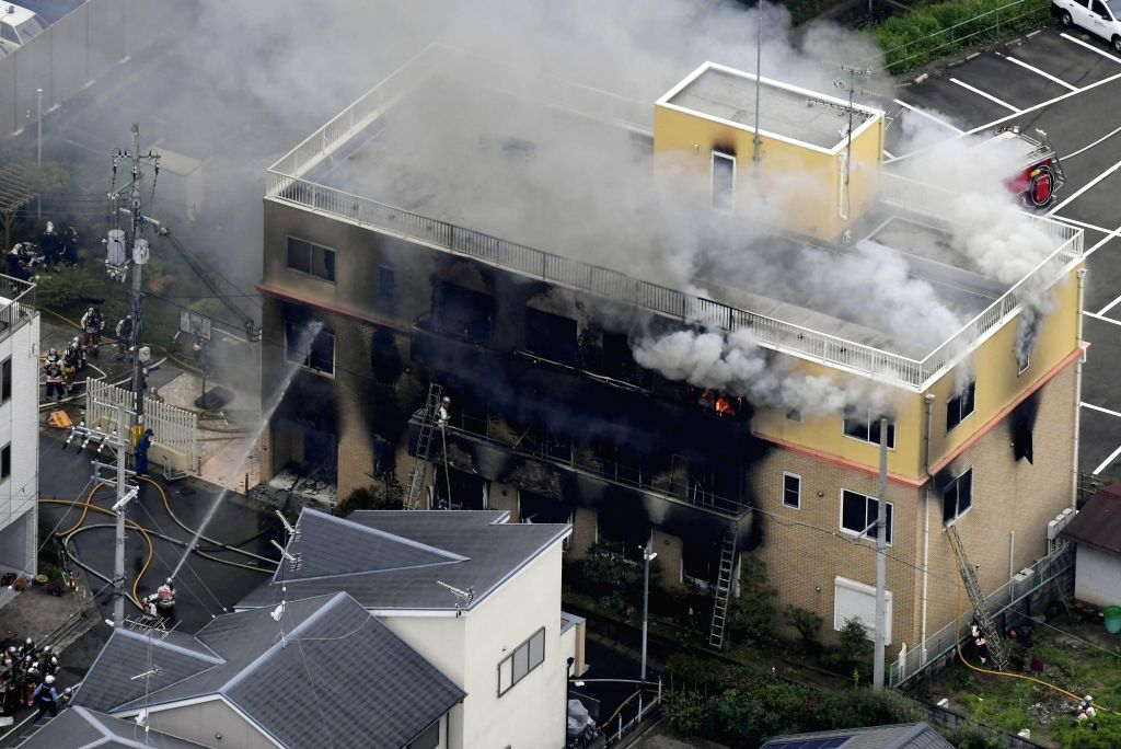 Firefighters extinguish a fire at an animation studio in Kyoto, Japan, July 18, 2019. A fire at an animation studio in the city of Kyoto, western Japan, has left several people dead and ...