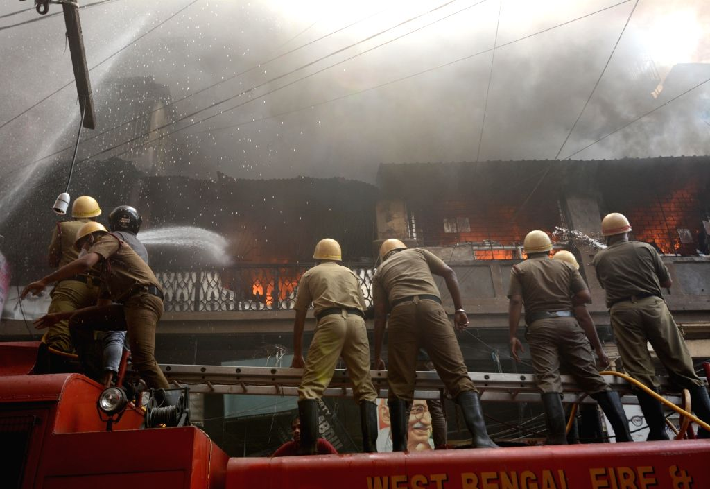 Firefighters extinguish a fire at four-storey building which is congested Colootola area,in Kolkata on Monday October 04 , 2021.