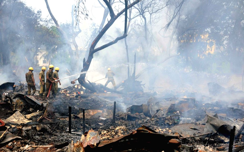 Firefighters fighting against fire in a slum area, at least 40 shanties in Salt Lake City's Central Park area were completely gutted in a fire that broke out on Monday morning in Kolkata on March 29, ...
