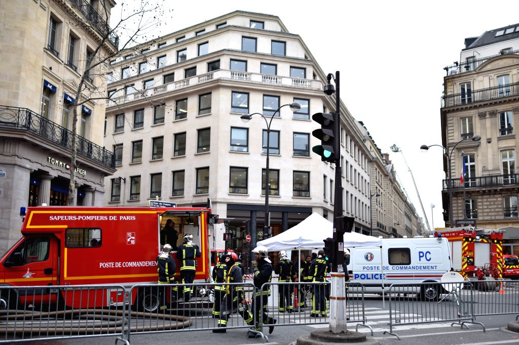 Firefighters gather in front of the Paris Ritz hotel in central Paris, capital of France, on Jan. 19, 2016. A fire broke out Tuesday morning at the Paris Ritz hotel ...