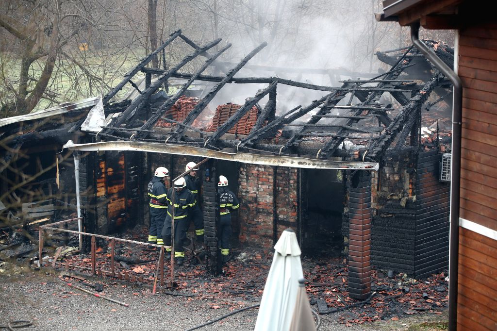 Firefighters inspect the burnt building of a home for the elderly in Andrasevac, Croatia, on Jan. 11, 2020. At least six people have died in a fire at a home for ...