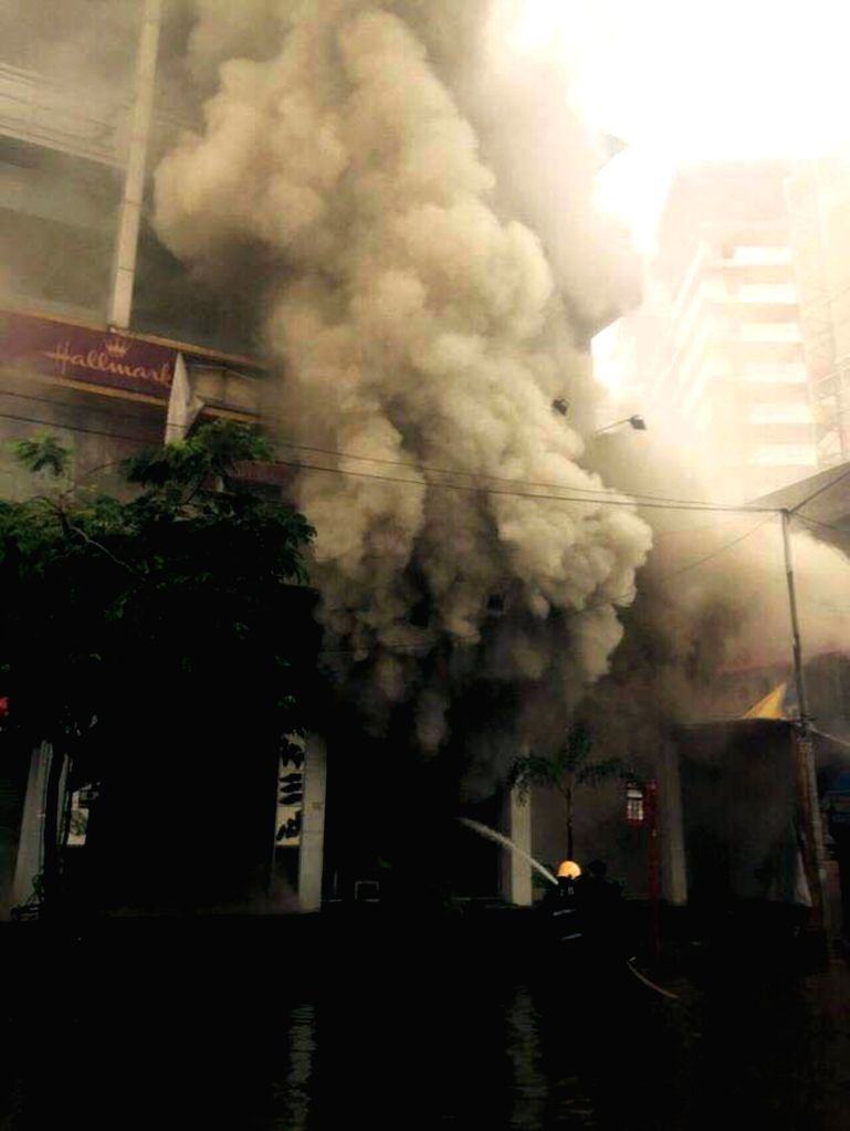 Firefighters try hard to douse a fire that broke out in a shopping complex in Bandra of Mumbai, on July 21, 2015. The building houses the fast-food joint KFC, popular Japanese joint Kofuku ...
