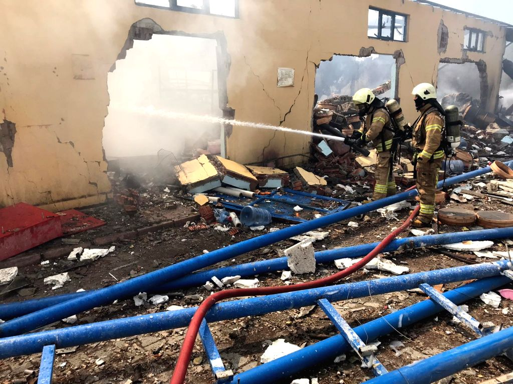 Firefighters work at the site of an explosion at a firework factory in Turkey's northwestern province of Sakarya, July 3, 2020. At least two people were killed and ...
