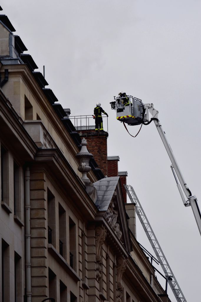 Firefighters work on the roof of the Paris Ritz hotel in central Paris, capital of France, on Jan. 19, 2016. A fire broke out Tuesday morning at the Paris Ritz hotel ...