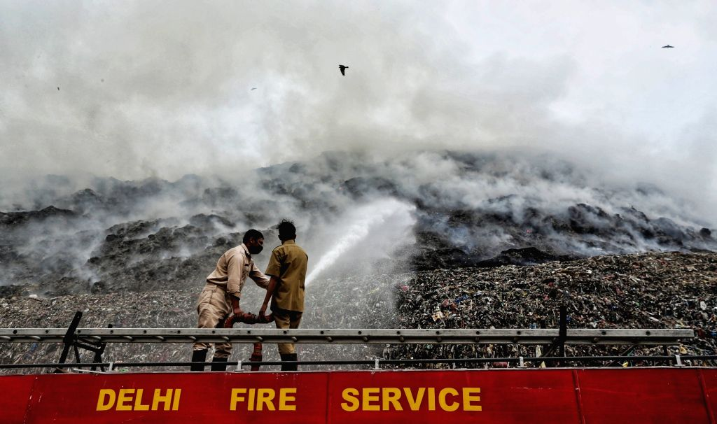 Firefighting operations at east Delhi's Ghazipur landfill continued as toxic fumes from the burning garbage filled the air. No injuries were reported from the spot, on Nov 25, 2020.