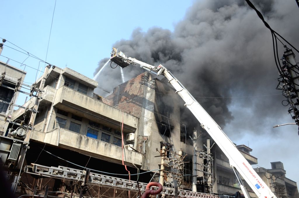 Firefighting operations underway after fire broke out in a shoe factory at DSIDC Narela, in outer Delhi on Oct 8, 2020. A total of 10 fire tenders were rushed to the spot to douse the ...