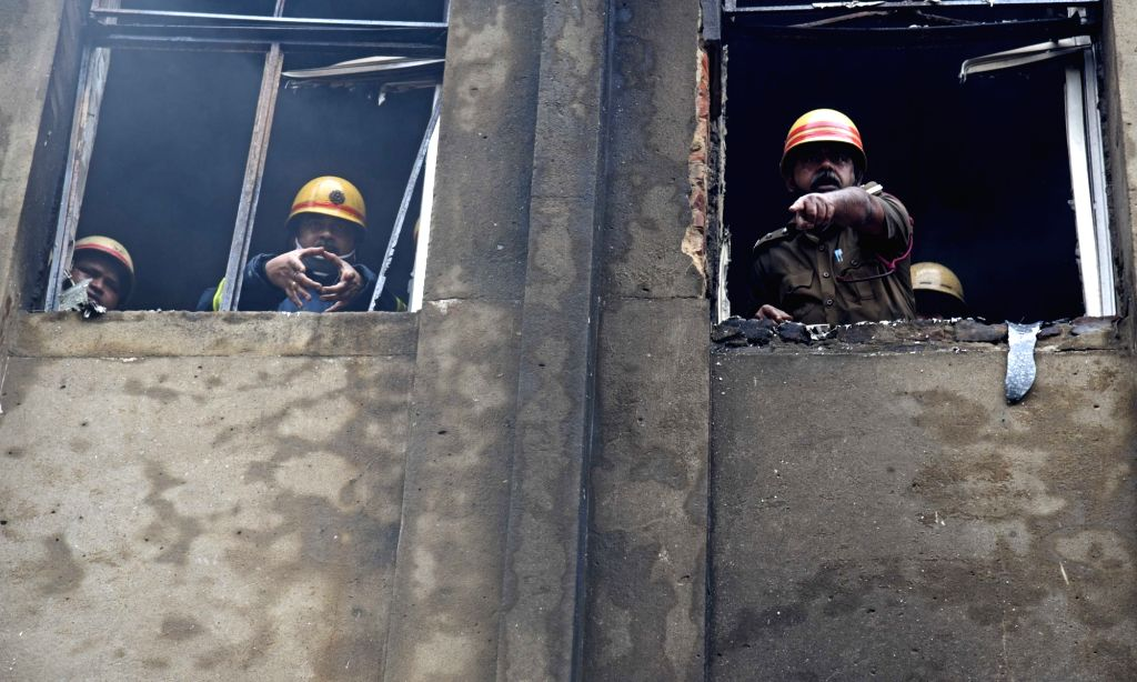 Firefighting operations underway at a multi- storey building in Burrabazar area, the second floor of which caught fire, in Kolkata on July 5, 2020. Eight fire tenders were pressed into ...