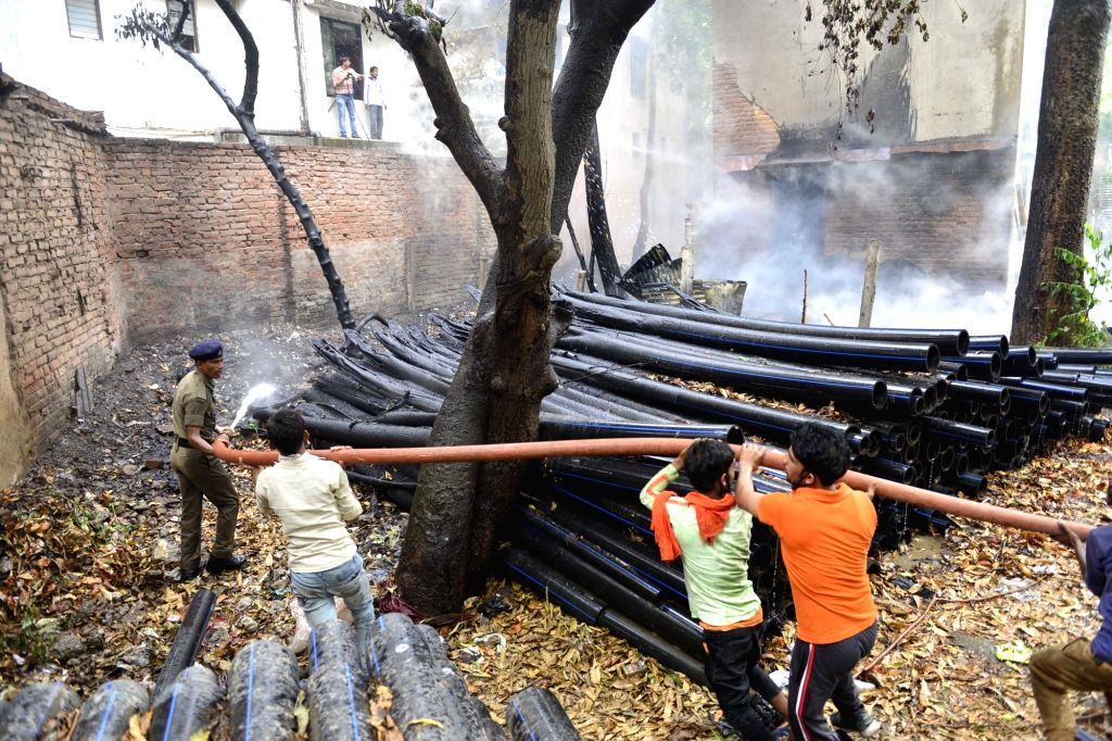 Firefighting operations underway at a plastic warehouse where a fire broke out, at Patliputra in Patna during the extended nationwide lockdown imposed to mitigate the spread of coronavirus; on ...