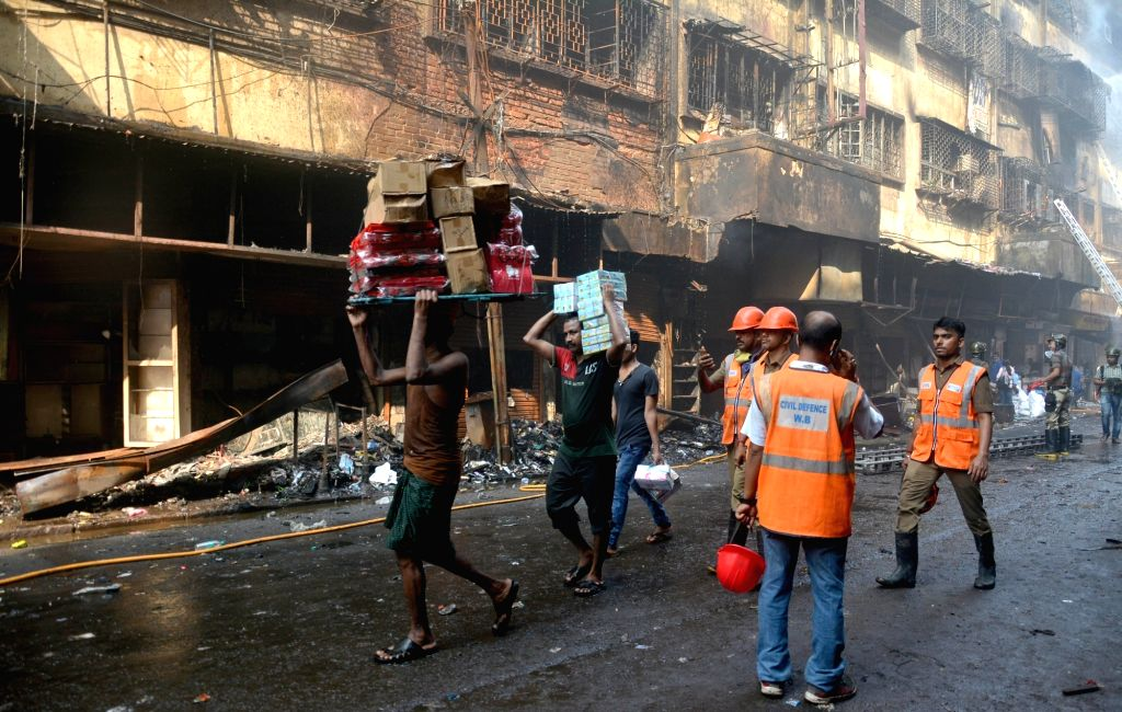 Firefighting operations underway at Bagree market where a fire broke out on Sunday; in Kolkata on Sept 18, 2018.