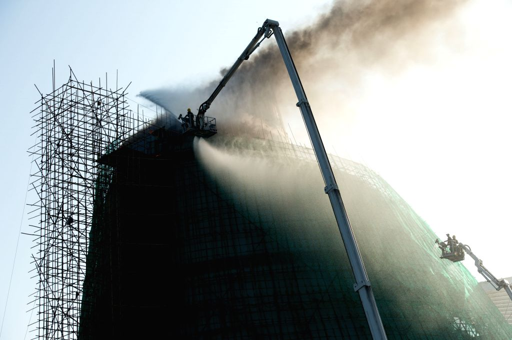Firemen try to put out the fire at the Macao Science Center in Macao, south China, Nov. 20, 2015. Fire broke out on top floor of Macao Science Center on Friday. About ...