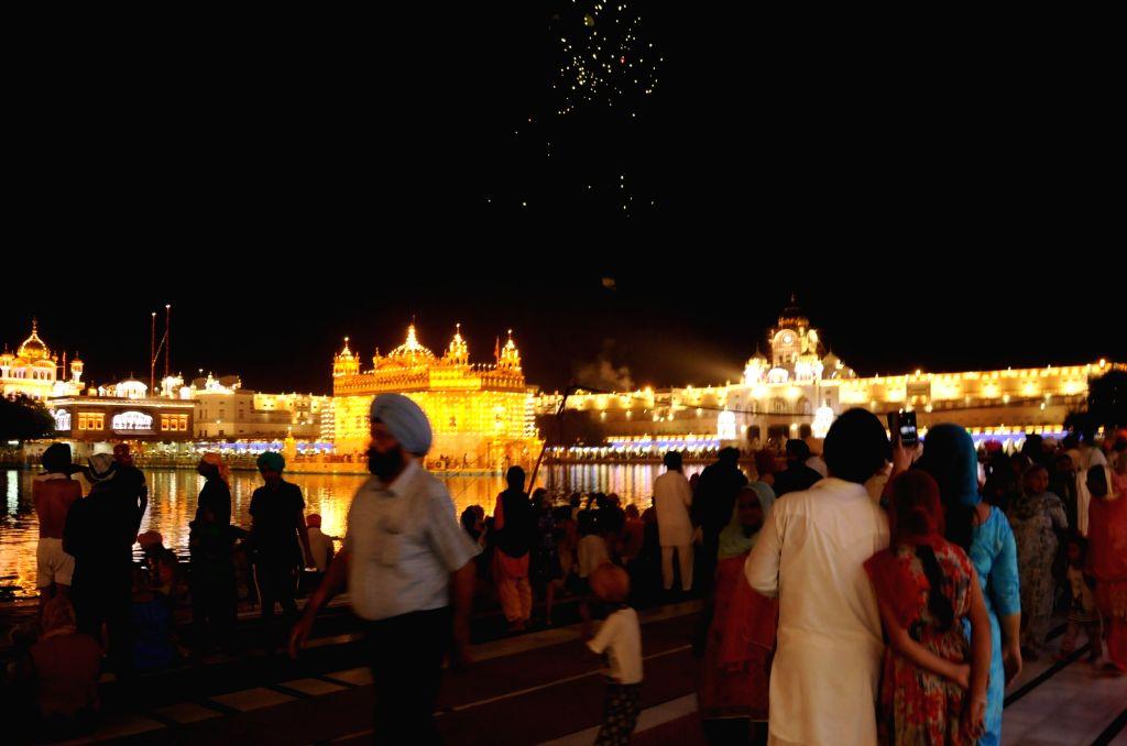 Firework at the Golden Temple on the occasion of eighth Sikh Guru Har Krishan Sahib's birth anniversary in Amritsar, on July 26, 2019.